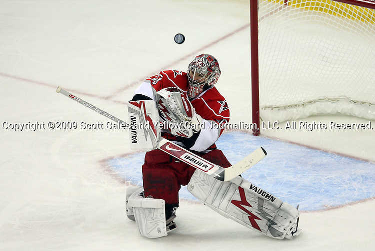 08 May 2009: Carolina's Cam Ward makes a save. The Carolina Hurricanes defeated the Boston Bruins 4-1 at the RBC Center in Raleigh, NC in Game 4 of their 2009 National Hockey League Eastern Conference Semifinal playoff series.