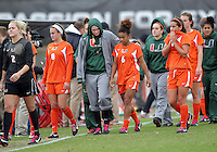COLLEGE PARK, MD - OCTOBER 28, 2012:  Players of Miami leave the field after losing to Maryland in an ACC  women's tournament 1st. round match at Ludwig Field in College Park, MD. on October 28. Maryland won 2-1 on a golden goal in extra time.