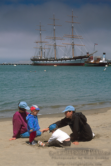 Family on beach at Aquatic Park, San Francisco, California