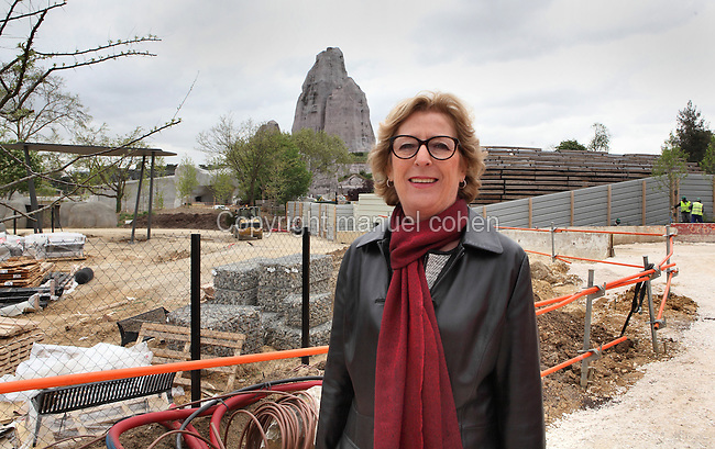 Genevieve Fioraso, Ministre de l'Enseignement Superieur et de la Recherche (Research and higher education minister), smiling for photographers with the Grand Rocher (Great Rock) in the background, D-1 year (J-1 an) for the new Parc Zoologique de Paris opening. On May 14, 2013, Le Museum national d'Histoire naturelle invited the journalists and photographers to check the work in progress and attend the first tree of the new zoo blessed by Genevieve Fioraso, Paris 12, France. Picture by Manuel Cohen
