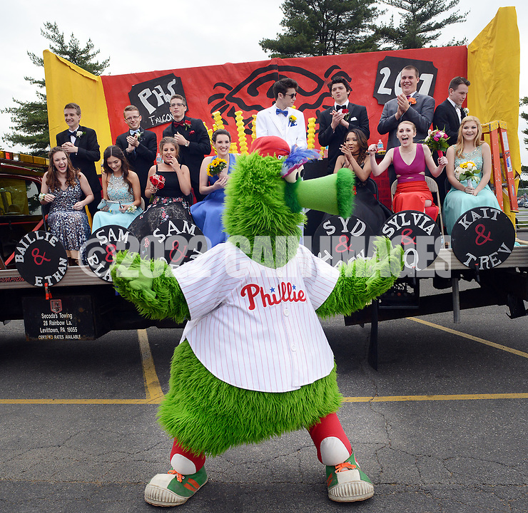 "The Phillie Phanatic directs traffic during the senior prom parade Saturday, May 20, 2017 at Pennsbury High School East in Fairless Hills, Pennsylvania. Pennsbury's senior prom is one of few still held at the school itself and this year featured the theme ""Yo Philly"" highlighting various features of Philadelphia. (Photo by William Thomas Cain)"