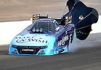 Apr 10, 2015; Las Vegas, NV, USA; NHRA funny car driver Tommy Johnson Jr during qualifying for the Summitracing.com Nationals at The Strip at Las Vegas Motor Speedway. Mandatory Credit: Mark J. Rebilas-