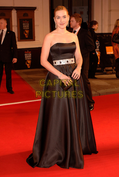 KATE WINSLET.Red Carpet Arrivals at The Orange British Academy Film Awards (BAFTA's) held at the Royal Opera House, Covent Garden, London, England, February 11th 2007..full length strapless black dress .CAP/IL.©Ian Leonard/Capital Pictures