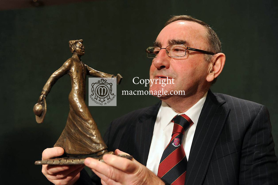 Former Supreme Court judge Hugh O'O'Flaherty pictured admiring a model of the proposed lifesized statue to his uncle Monsignor Hugh O'Flaherty - (The Scarlet Pimpernel) which will be erected in Killarney. .Picture by Don MacMonagle