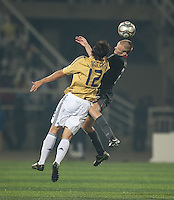 Jared Watts heads the ball over Alvaro Morata (12). Spain defeated the U.S. Under-17 Men National Team  2-1 at Sani Abacha Stadium in Kano, Nigeria on October 26, 2009.