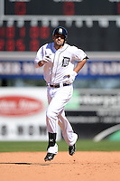 Detroit Tigers third baseman Nick Castellanos (9) runs the bases after a home run during a spring training game against the St. Louis Cardinals on March 3, 2014 at Joker Marchant Stadium in Lakeland, Florida.  Detroit defeated St. Louis 8-5.  (Mike Janes/Four Seam Images)