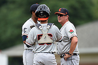Connecticut Tigers pitching coach Mark Johnson (44) talks with catcher Tim Remes (56) and pitcher Fernando Perez (31) during the first game of a doubleheader against the Batavia Muckdogs on July 20, 2014 at Dwyer Stadium in Batavia, New York.  Connecticut defeated Batavia 5-3.  (Mike Janes/Four Seam Images)