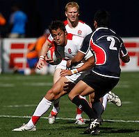 February 14 2009, San Diego, CA, USA:  The IRB USA Sevens Tournament at Petco Park in Downtown San Diego.  England's Chris Cracknell (L) evades Japanese player Masahiro Tsuiki during day one action.