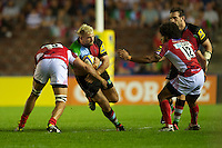 Joe Marler of Harlequins is tackled by Matt Corker of London Welsh during the Aviva Premiership match between Harlequins and London Welsh at the Twickenham Stoop on Friday 7th September 2012 (Photo by Rob Munro)