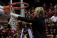 BERKELEY, CA - MARCH 30: Assistant coach Kate Paye cuts down the net following Stanford's 74-53 win against the Iowa State Cyclones on March 30, 2009 at Haas Pavilion in Berkeley, California.