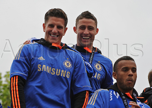 20.05.2012 Chelsea London, England. Champions League Cup Winners Parade atop the traditional open-top bus to the Stamford Bridge Ground. Picture shows Gary Cahill and Bertrand