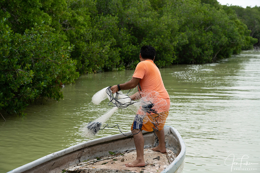 A fisherman casts his net into the brackish waters of the marine estuary at the Ria Lagartos Biosphere Reserve, a UNESCO World Biosphere Reserve in Yucatan, Mexico.