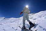 A backcountry skier climbs toward a ridgeline in the Elk Mountains of Colorado.