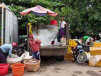 The open market in Mandalay, Myanmar Selling Ice to the Market vendors