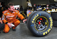 Feb 13, 2008; Daytona Beach, FL, USA; Nascar Sprint Cup Series driver Joe Nemechek examines a Goodyear Tire during practice for the Daytona 500 at Daytona International Speedway. Mandatory Credit: Mark J. Rebilas-US PRESSWIRE