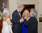 United States Secretary of State John F. Kerry, left center, shakes hands with conductor Seiji Ozawa, right, one of the five recipients of the 38th Annual Kennedy Center Honors, as fellow recipients actress and singer Rita Moreno, left, and singer-songwriter Carole King, right center, look on following a dinner hosted by Secretary Kerry in their honor at the U.S. Department of State in Washington, D.C. on Saturday, December 5, 2015.  The 2015 honorees are: singer-songwriter Carole King, filmmaker George Lucas, actress and singer Rita Moreno, conductor Seiji Ozawa, and actress and Broadway star Cicely Tyson.<br /> Credit: Ron Sachs / Pool via CNP