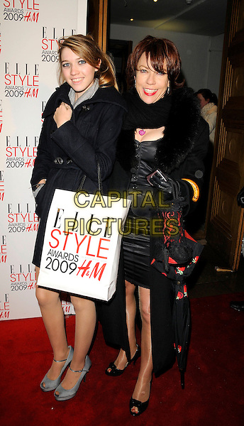 KATHY LETTE & DAUGHTER GEORGINA .Attending the Elle Style Awards 2009 at Big Sky London, England,.February 9th 2009..full length black coat mother family fur collar  paper bag goody goodie.CAP/CAN.©Can Nguyen/Capital Pictures