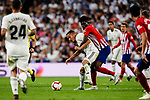Lucas Vazquez of Real Madrid (L) fights for the ball with Thomas Teye of Atletico de Madrid (R) during their La Liga  2018-19 match between Real Madrid CF and Atletico de Madrid at Santiago Bernabeu on September 29 2018 in Madrid, Spain. Photo by Diego Souto / Power Sport Images