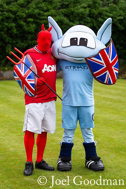 © Joel Goodman - 07973 332324 . 03/06/2012 . Manchester , UK . Bowling green at Ye Golden Lion pub , Old Market Street, Blackley village . Manchester United and Manchester City mascots Moonchester and the Red Devil . Moonchester played by Kevin Lang (official) and Red Devil played by Mick Moran , 40 , from Blackley , who is actually a Manchester City fan and not the official Manchester United mascot . Photo credit : Joel Goodman