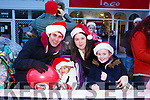 Waiting for Santa at CH Chemist Christmas Parade Tralee on Saturday were Chris Quain, Lucy Quain, Celine Maloney and Ruby Foley