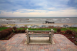 A Bench Overlooking The Lake Michigan Surf On A Cold And Rainy Early Spring Day At Wind Point, Racine Wisconsin, USA