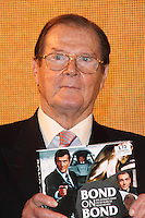 London - Sir Roger Moore signs his book 'Bond on Bond' at HMV Oxford Street, London - October 22nd 2012..Photo by Keith Mayhew