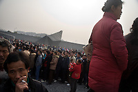 "People mill around the Assembly Ground outside the Memorial Hall of the Nanjing Massacre in Nanjing, China, on Thursday, Dec. 13, 2007. After two years of renovations, the Memorial Hall of the Nanjing Massacre reopened to the public on Dec. 13, 2007, the 70th anniversary of the 6-week massacre by Japanese troops that started Dec. 13, 1937 and claimed more than 300,000 lives.  The commemoration comes amid renewed controversy about the accuracy of historical accounts of the massacre.  The massacre is also known as ""The Rape of Nanking."""