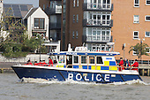 London, UK. 9 September 2014. Chelsea Pensioners on a Police Boat. The Tall Ships that have taken part in the Royal Greenwich Tall Ships Festival 2014 leave Greenwich in a Parade of Sail down the River Thames.