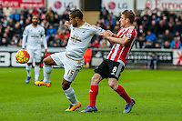 Wayne Routledge of Swansea City  and Steven Davis of Southampton  in action during the Barclays Premier League match between Swansea City and Southampton  played at the Liberty Stadium, Swansea  on February 13th 2016