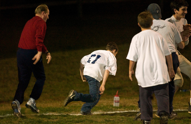 "11/04/05.Rep. Jim McCrery, R-La., chases son, Scott, 11, who plays for the McLean Mustangs, after his Scott intercepted a pass while covering him during a touch-football game of parents against sons at Lewinsville Park in McLean. McCrery's recap of the game's results:  ""the score was 13-7 in favor of the kids, who scored the winning touchdown on the last play of the game by recovering a fumble when the snap flew over the parents' quarterback's head and was then kicked all the way to the end zone!"".CONGRESSIONAL QUARTERLY PHOTO BY SCOTT J. FERRELL."