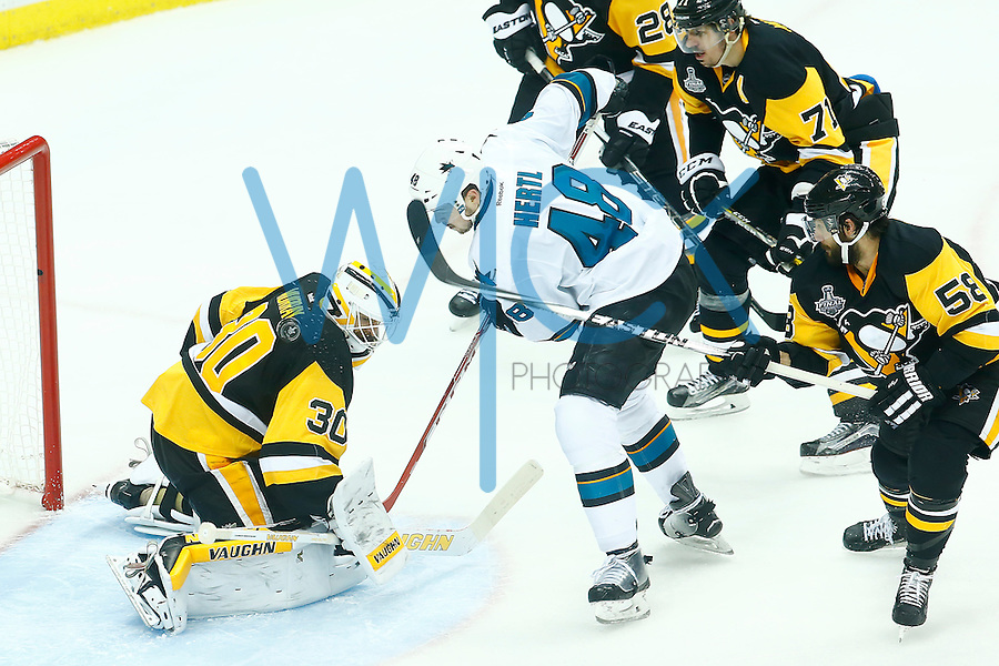 Matt Murray #30 of the Pittsburgh Penguins makes a save on Tomas Hertl #48 of the San Jose Sharks in the third period during game one of the Stanley Cup Final at Consol Energy Center in Pittsburgh, Pennslyvania on May 30, 2016. (Photo by Jared Wickerham / DKPS)
