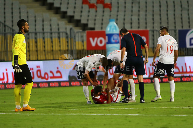 "Al Ahly players compete against with Zamalek players during their Egyptian Premier League derby soccer match at Borg El Arab ""Army Stadium"" near Alexandria, Egypt, February 9, 2016. Photo by Amr Sayed"