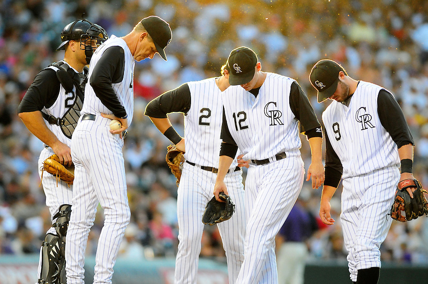 August 11, 2009: Rockies manager Jim Tracy, and catcher Chris Iannetta, shortstop Troy Tulowitzki, 2nd baseman Clint Barmes, and 3rd baseman Ian Stewart hang their heads while waiting for a pitching change during a regular season game between the Pittsburgh Pirates and the Colorado Rockies at Coors Field in Denver, Colorado. *****For editorial use only*****