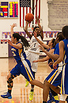 Cedar Ridge sophomore Danielle Rainey attempts a shot against Pflugerville Friday at Cedar Ridge.  The Raiders lost to the Panthers 70-66.  (LOURDES M SHOAF for Round Rock Leader.)