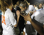 N(Worcester Ma 111513) Newtown North High girls line up to kiss the trophy after winning the state final on penalty kicks, during the MIAA State Girls Soccer Division 1 final, Friday, at Worcester State College in Worcester. (Jim Michaud Photo) For Saturday