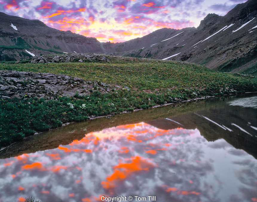 Sunrise in an alpine tarn, Maroon Bells/Snowmass Wilderness, Colorado, West Maroon Pass, Elk Mountains, July