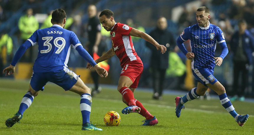 Blackburn Rovers' Elliott Bennett takes on Sheffield Wednesday's Vincent Sasso and Jack Hunt<br /> <br /> Photographer Alex Dodd/CameraSport<br /> <br /> The EFL Sky Bet Championship - Sheffield Wednesday v Blackburn Rovers - Tuesday 14th February 2017 - Hillsborough - Sheffield<br /> <br /> World Copyright &copy; 2017 CameraSport. All rights reserved. 43 Linden Ave. Countesthorpe. Leicester. England. LE8 5PG - Tel: +44 (0) 116 277 4147 - admin@camerasport.com - www.camerasport.com