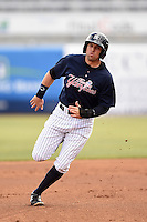 Tampa Yankees outfielder Jake Cave (18) during a game against the Daytona Cubs on April 13, 2014 at George M. Steinbrenner Field in Tampa, Florida.  Tampa defeated Daytona 7-3.  (Mike Janes/Four Seam Images)