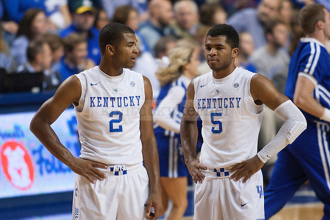 Guards Aaron and Andrew Harrison of the Kentucky Wildcats talk during the second half of the game against the Providence Friars at Rupp Arena on Sunday, November 30, 2014 in Lexington, Ky. Kentucky defeated Providence 58-38. Photo by Michael Reaves | Staff