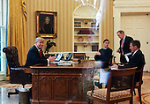 US President Donald Trump speaks with the King of Saudi Arabia, Salman bin Abd al-Aziz Al Saud in the Oval Office of the White House surrounded by  Senior Adviser to the President Jared Kushner (2L), Press Secretary Sean Spicer (2R), and Security Advisor Michael Flynn (R), January 29, 2017, Washington, DC. <br /> Credit: Aude Guerrucci / Pool via CNP