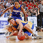 SIOUX FALLS, SD - MARCH 10: Heidi Hoff #42 from the University of South Dakota battles for the loose ball with Kerry Young #10 from South Dakota State University in the first half of the Summit League Championship Tournament game Tuesday at the Denny Sanford Premier Center in Sioux Falls, SD. (Photo by Dave Eggen/Inertia)