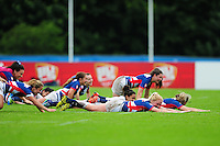 The Great Britain team celebrate after the match. FISU World University Championship Rugby Sevens Women's 5th/6th place match between Great Britain and Italy on July 9, 2016 at the Swansea University International Sports Village in Swansea, Wales. Photo by: Patrick Khachfe / Onside Images