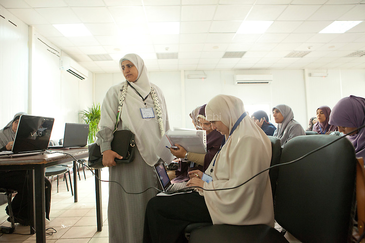 Muslim Sisters take notes during a multimedia lecture by Dr Manal Abul Hassan, in FJP headquarters in Downtown, Cairo. Egypt, October 2012.