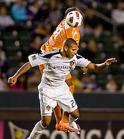 LA Galaxy defender Leonardo De Silva (22) battles Puerto Islanders Nicholas Addlery (11). The Puerto Rico Islanders defeated the LA Galaxy 4-1 during CONCACAF Champions League group play at Home Depot Center stadium in Carson, California on Tuesday July 27, 2010.
