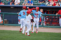 Peoria Chiefs Edwin Figueroa (13) congratulates Wadye Ynfante (3) for hitting a home run during a Midwest League game against the Bowling Green Hot Rods at Dozer Park on May 5, 2019 in Peoria, Illinois. Peoria defeated Bowling Green 11-3. (Zachary Lucy/Four Seam Images)