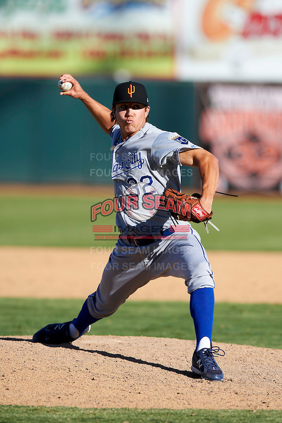 Surprise Saguaros pitcher Edwin Carl #32, of the Kansas City Royals organization, during an Arizona Fall League game against the Phoenix Desert Dogs at Phoenix Municipal Stadium on October 18, 2012 in Phoenix, Arizona.  The game was called after eleven innings with a 2-2 tie.  (Mike Janes/Four Seam Images)