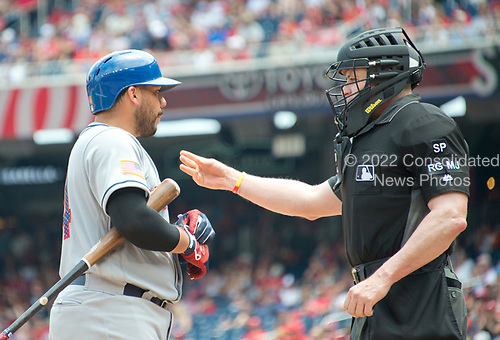 New York Mets catcher Rene Rivera (44) argues a called third strike with umpire Carlos Torres (37) in the fifth inning against the Washington Nationals at Nationals Park in Washington, D.C. on Tuesday, July 4, 2017.  The Nationals won the game 11 - 4.<br /> Credit: Ron Sachs / CNP<br /> (RESTRICTION: NO New York or New Jersey Newspapers or newspapers within a 75 mile radius of New York City)