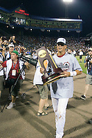 South Carolina OF Whit Merrifield carries the championship trophy following Game Two of the NCAA Division One Men's College World Series Finals on June 29th, 2010 at Johnny Rosenblatt Stadium in Omaha, Nebraska.  (Photo by Andrew Woolley / Four Seam Images)