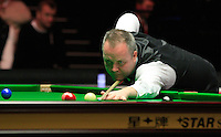 John Higgins plays a red ball during the Dafabet Masters Q/F 4 match between John Higgins and Stuart Bingham at Alexandra Palace, London, England on 15 January 2016. Photo by Liam Smith / PRiME Media Images