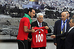 Palestinian President Mahmoud Abbas receives the Palestinian national football team which won the AFC Challenge Cup, at Abbas's office in the West Bank city of Ramallah on June 1, 2014. Palestine qualified for their maiden Asian Cup appearance with a 1-0 win over injury-hit Philippines in the final of the AFC Challenge Cup in Maldives. Photo by Issam Rimawi